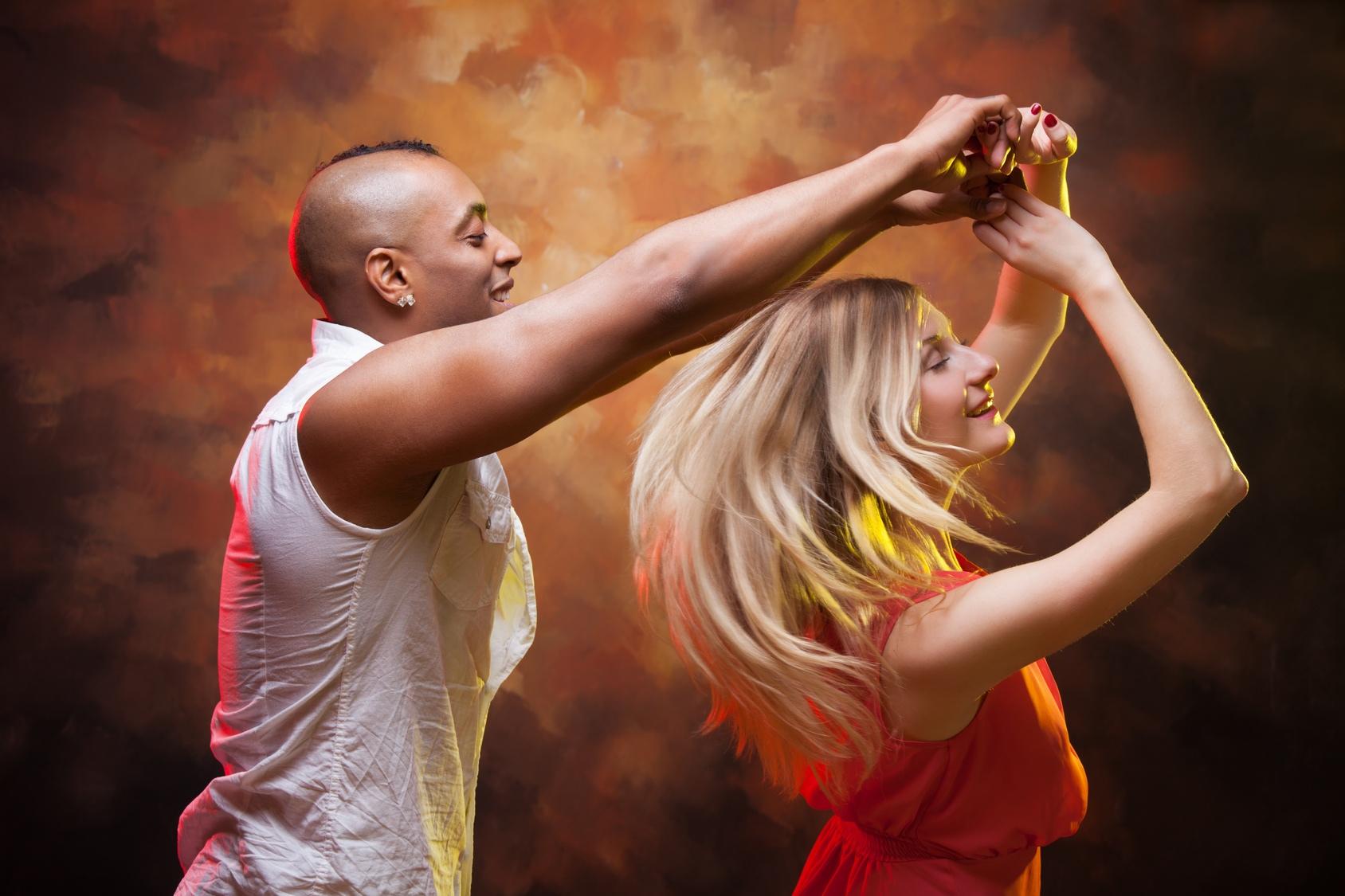 <p>Young couple dances Caribbean Salsa</p>